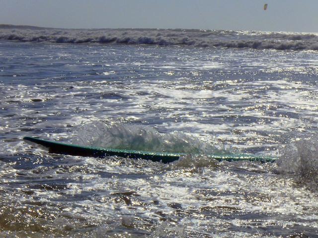 Surfing Essaouira beach, Morocco.