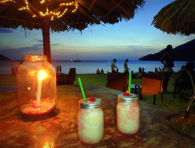 Pina coloada at sunset at Taco Beach Bar in Taganga, Colombia