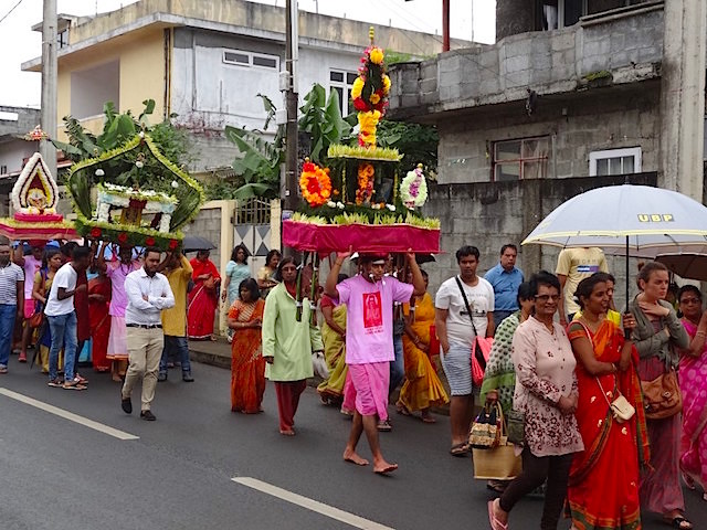 Colorful Indian procession in a little town in Mauritius