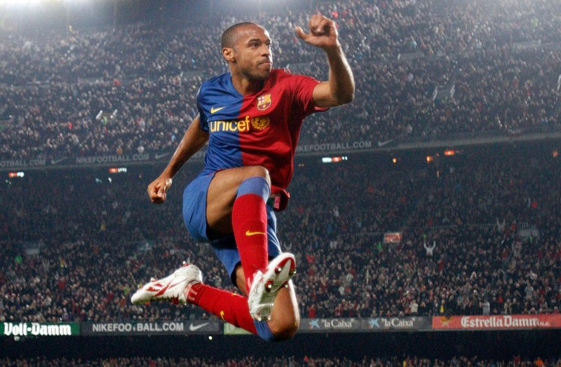 Barcelona's Henry celebrates a goal against Malaga during their Spanish First Division soccer league match at Nou Camp Stadium in Barcelona