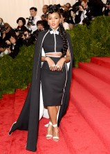 Janelle Monae wears an H&M two piece cape look with Nicholas Kirkwood shoes