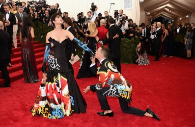 Katy Perry wears a Moschino dress, designed by Jeremy Scott (on the right)