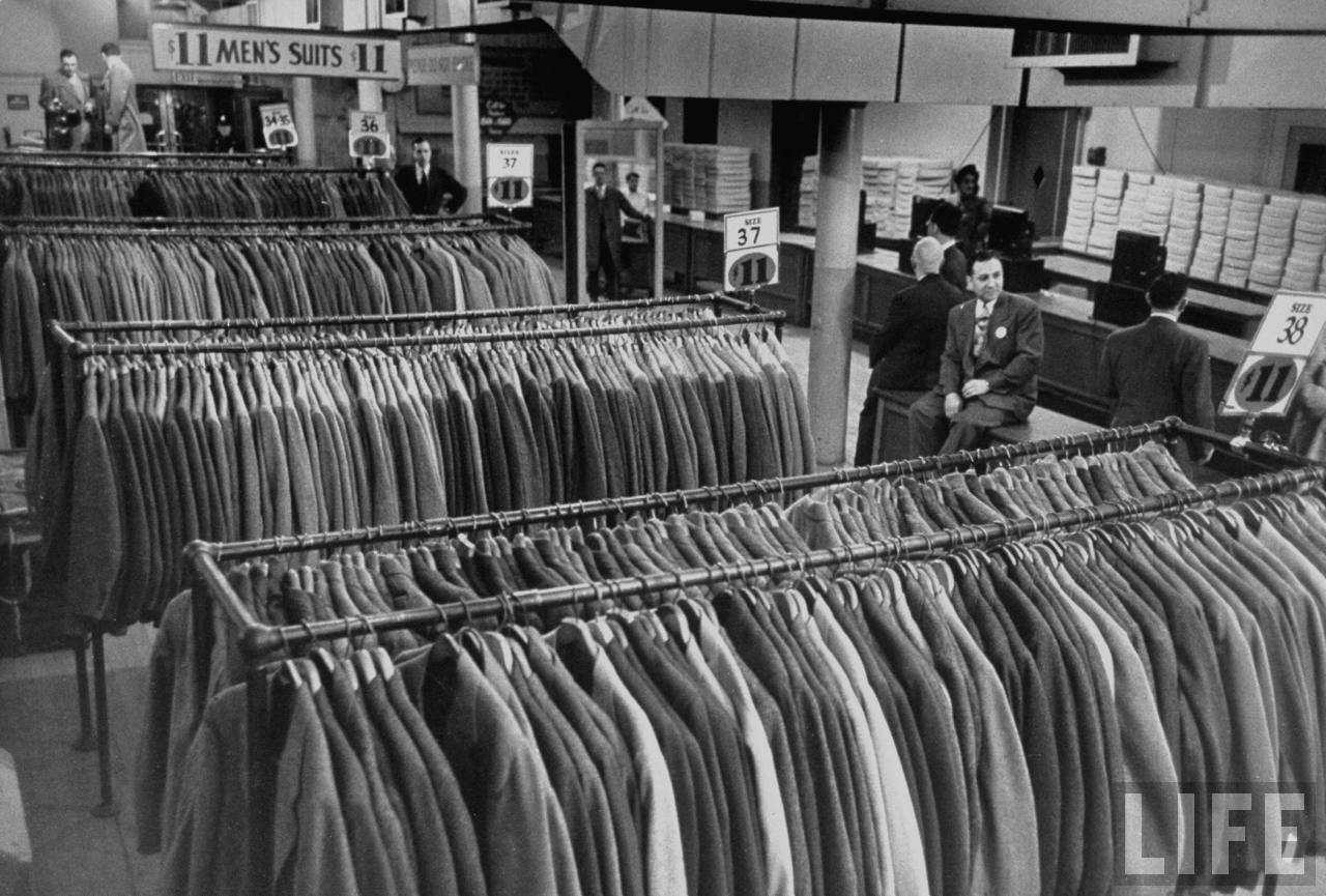 Clerks at Filene's Department Store's Bargain Basement preparing to admit customers for a sale on men's suits and topcoats.  --Boston, MA 1949