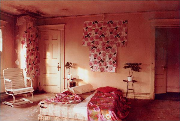 """Upon seeing the house's state of disrepair, Mr. Bradlee failed to share his wife's enthusiasm. """"I wasn't sure I wanted to buy the house,"""" he said. """"There were 52 dead cats in it, and funeral arrangements had to be made for each one."""" At left, the master bedroom, which had been used by Big Edie."""