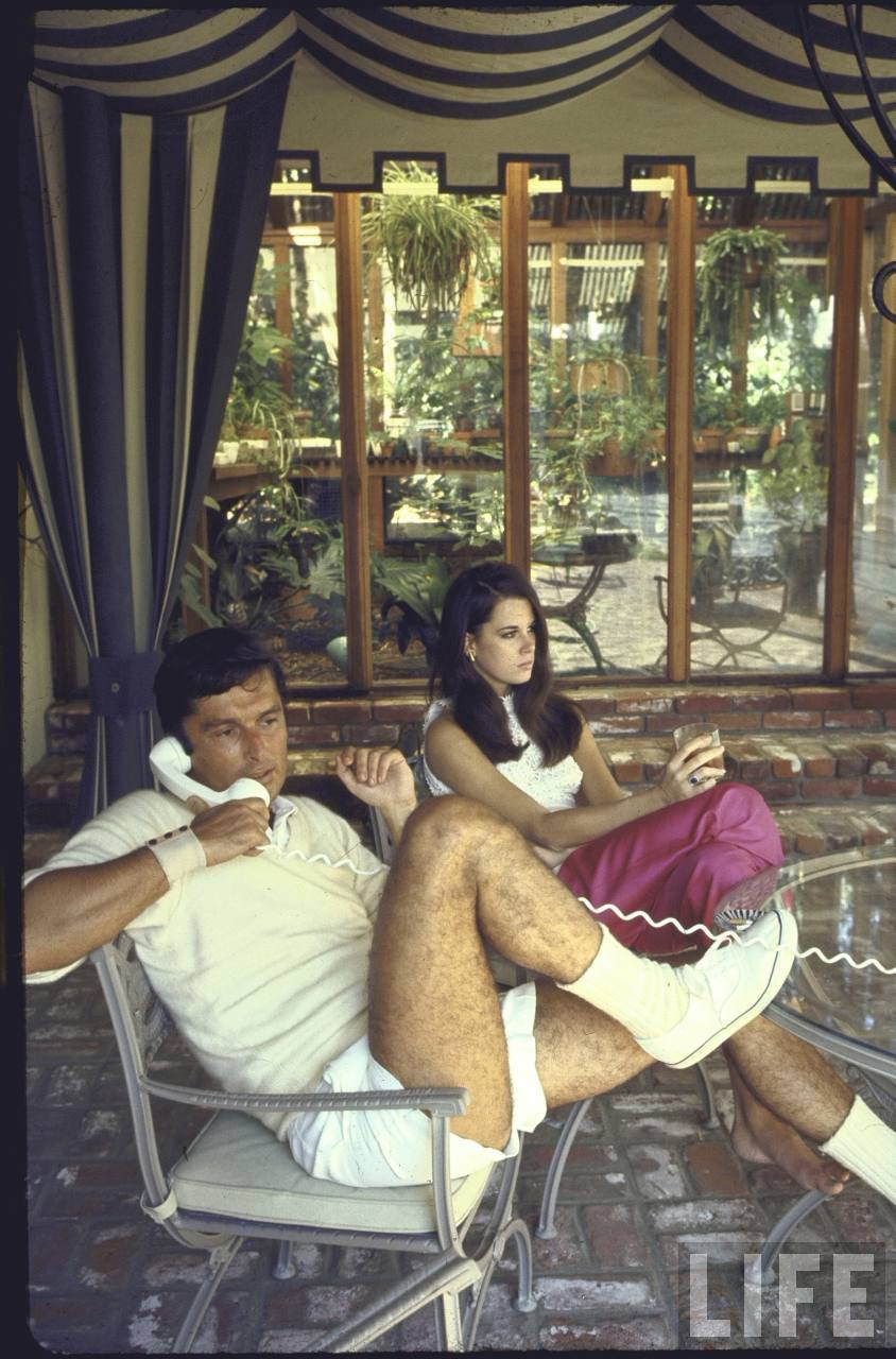 Film director Robert Evans and girlfriend Libby Boehmer at home-- Beverly Hills, CA 1968.