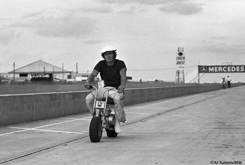 Steve McQueen screwing around before the Sebring, Florida 12-Hour Race (Tri-X).  You can clearly see that his left foot is in a cast.