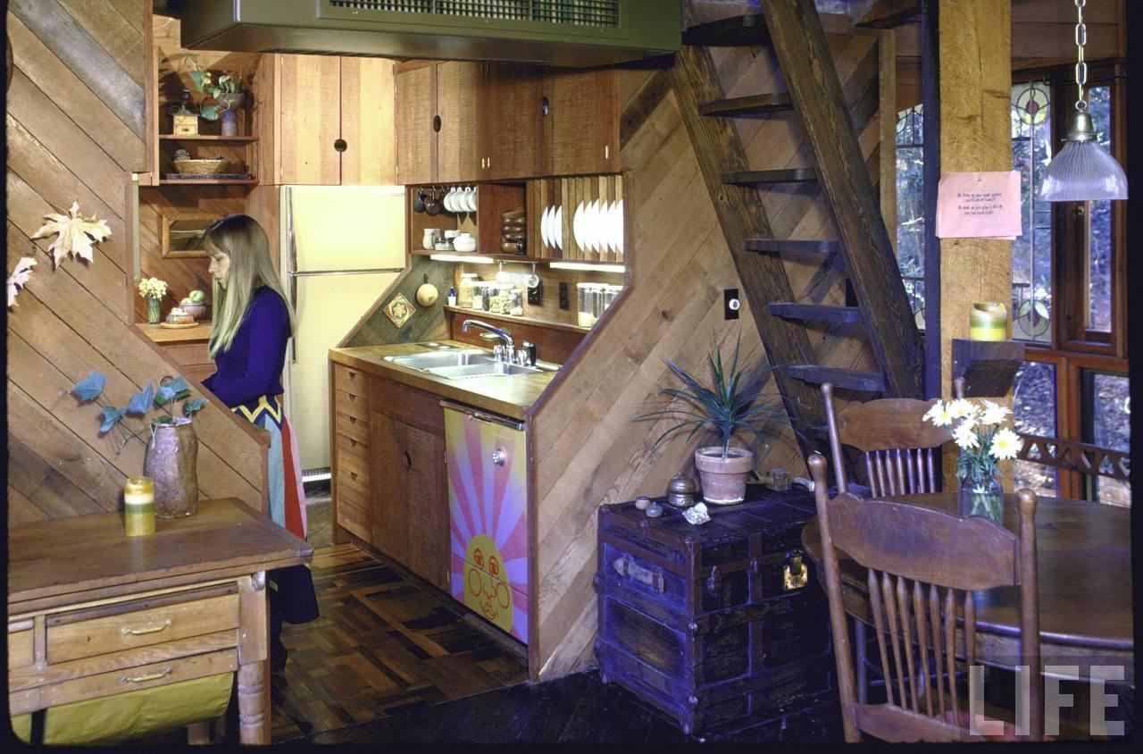 Here, Kathleen cooks dinner in the kitchen.
