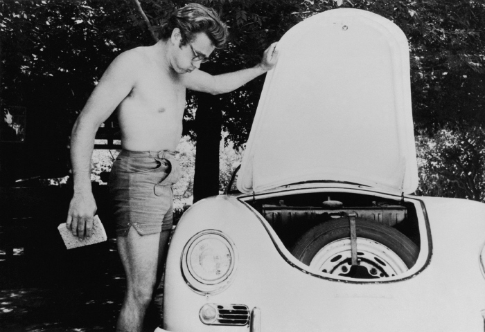 James Dean in happier days washing his first Porsche-- a Speedster convertible.