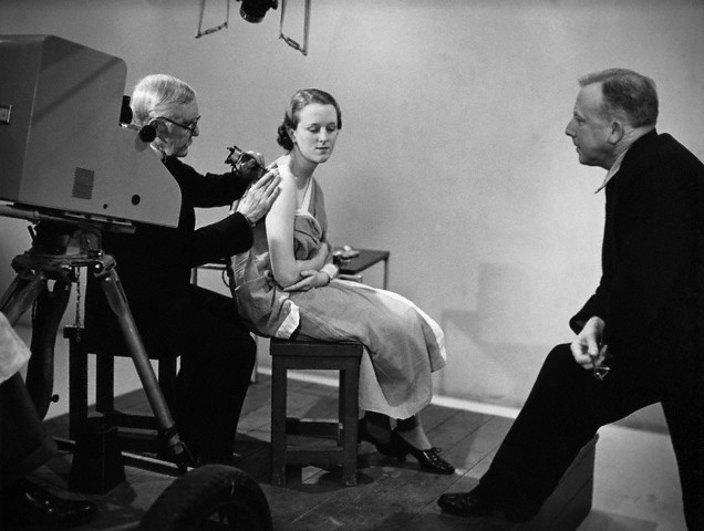 George Burchett demonstrating tattooing in a UK series, host S.P.B. Mais is at right  --1938.