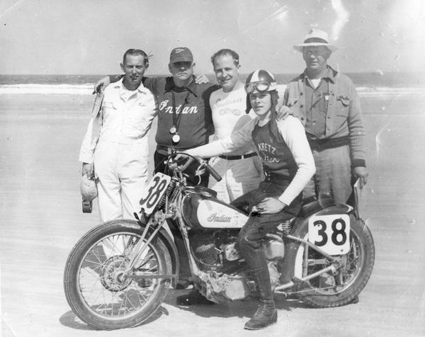 Ed Kretz Jr. on the Indian, and Ed Kretz Sr. in the background-- 1950 Daytona