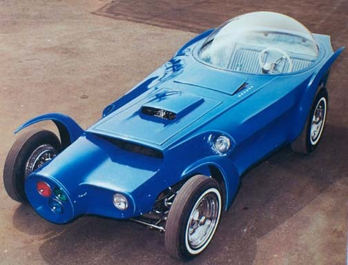"""Ed """"Big Daddy"""" Roth's Orbitron '64.  Orbitron as Ed put it """"was a failure at the shows"""".  He beleived that covering the shiny '55 Chevy engine was to blame for its downfall. Inside features a TV, Cragar steering wheel, Moon gas pedal, Hurst shifter and a Dixco tachometer.  Ed got the idea to use the three primary colored headlights, so when they turned on and focused in one spot they would create a white beam."""