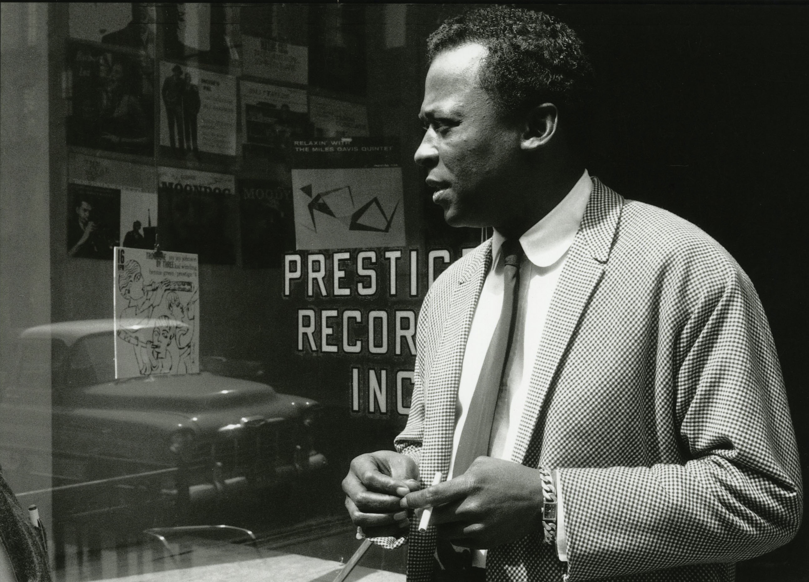Miles Davis' style was always very thought out, there were no accidents -- every detail said something about him and was there for a reason.  It's easy to look at this picture and miss the subtle, but very telling, details.  Note-- the absence of a breast pocket on the sportcoat, or buttons on the sleeve, and the rounded club, or penny collar..