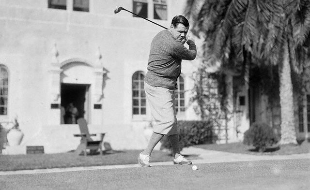 Original caption -- Down the Fairway. Approaching the pink of condition and prophesying a record crop of home runs for the coming season, the mighty Bambino of baseball, George Herman Ruth, arrived at St. Petersburg, Fla., for his annual pre-season sessions on golf links. Here is the Babe getting sessions for a hearty swing at the little pill. -- Feb. 11th, 1931.