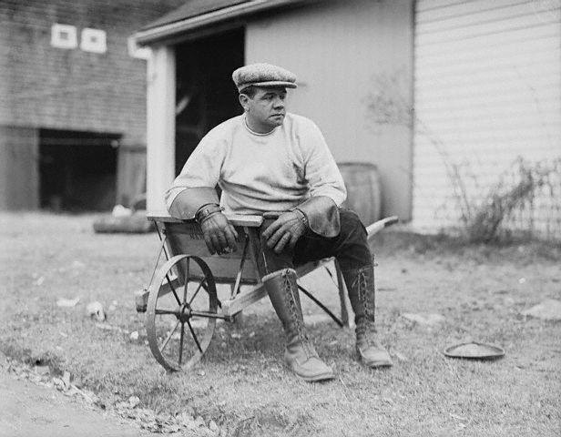 Original caption -- Yankees' champion batter, Babe Ruth, resting in a wheelbarrow on his farm in Sudbury, Massachusetts. -- Dec. 2nd, 1922.