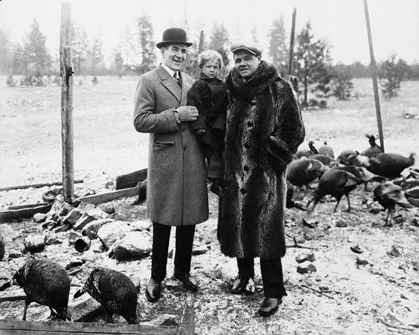 Original caption -- James J. Corbett, once heavyweight champion, a young orphan, and Babe Ruth, King of Swatsmiths, on the turkey farm of the Daven Port Hotel where Babe Ruth killed several of the gobblers for the Thanksgiving dinner given the orphans. -- Nov. 26th, 1936.