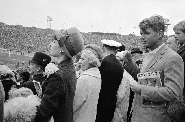 1964, Philadelphia, PA -- Senator elect Robert Kennedy clutches a program under his arm as he watches the Army-Navy game from the stands of the stadium named after his late brother, and former President, JFK.  President Kennedy had attended the classic service rivalry during the two years he was in office. -- Image by © Bettmann.