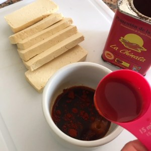 slices of tofu with tamari, maple syrup and smoked paprika for marinade