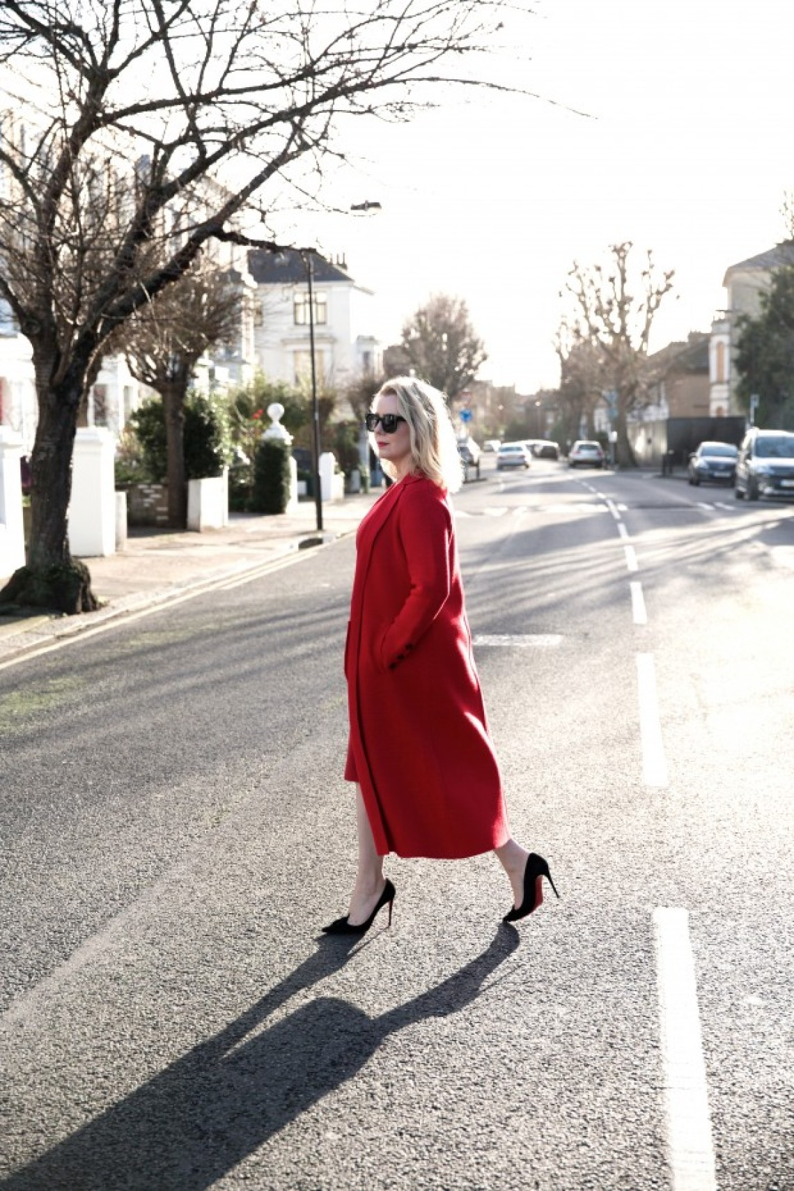 Blonde in red coat