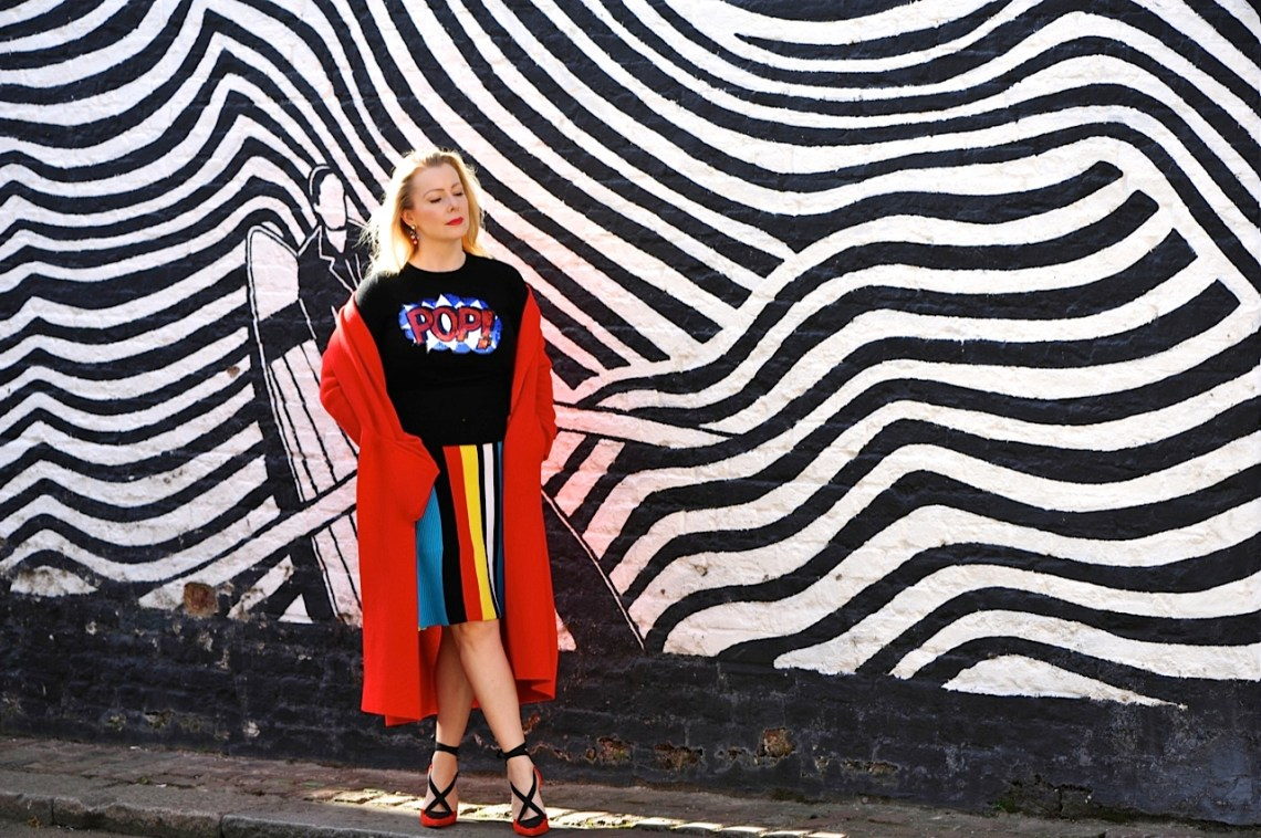 POP Art jumper, red coat and striped skirt