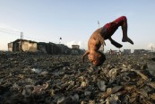 A boy plays at a garbage dump where hundreds of people stay and make a living out of recycling waste and making charcoal in the Tondo section of Manila, in 2007.