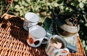 enamel mugs above shot