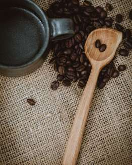 long wooden coffee scoop