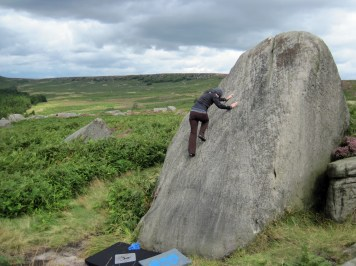 Valerie climbing Bog Standard Slab on The Sentry boulder at Burbage South Valley.