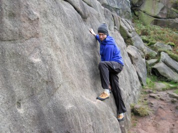 Me making the first few moves on the Slab 2 problem on Blister Slab.