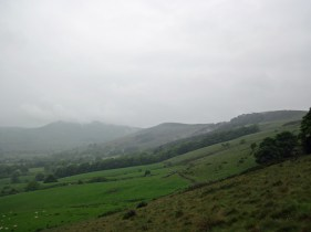 The Mam Tor ridge in cloud and rain.