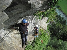 Nick waiting for a chance to continue climbing on a congested section of the Klettersteig Huterlaner.