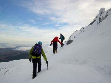 Bill teaching Sam and Conor movement skills on the slopes of Aonach an Nid.