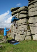 Me climbing boulder problem The Runnel (3+) at Hound Tor.