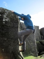 Me climbing One Inch Arete (VB 4a) in the Little Quarry at Curbar Edge.