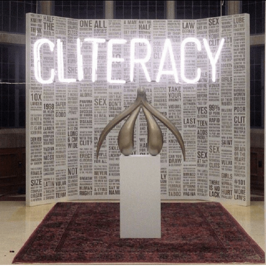 The Cliteracy exhibit, featuring a gold clit statue
