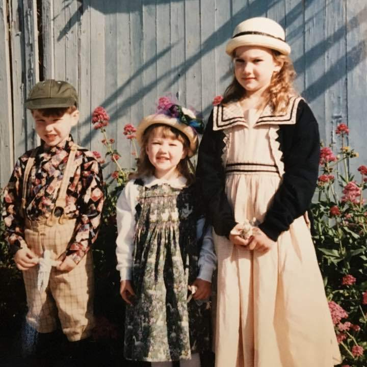 Three kids in handmade clothes
