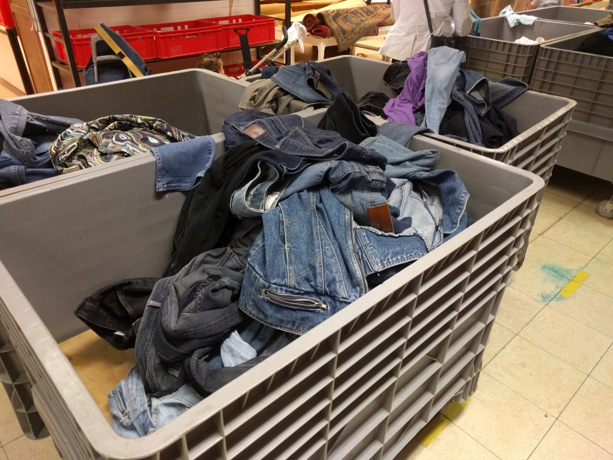 Resale shop bins of denim from Denim Refashioners year