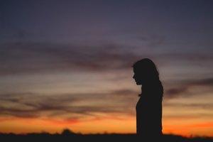 silhouette of female in the dark