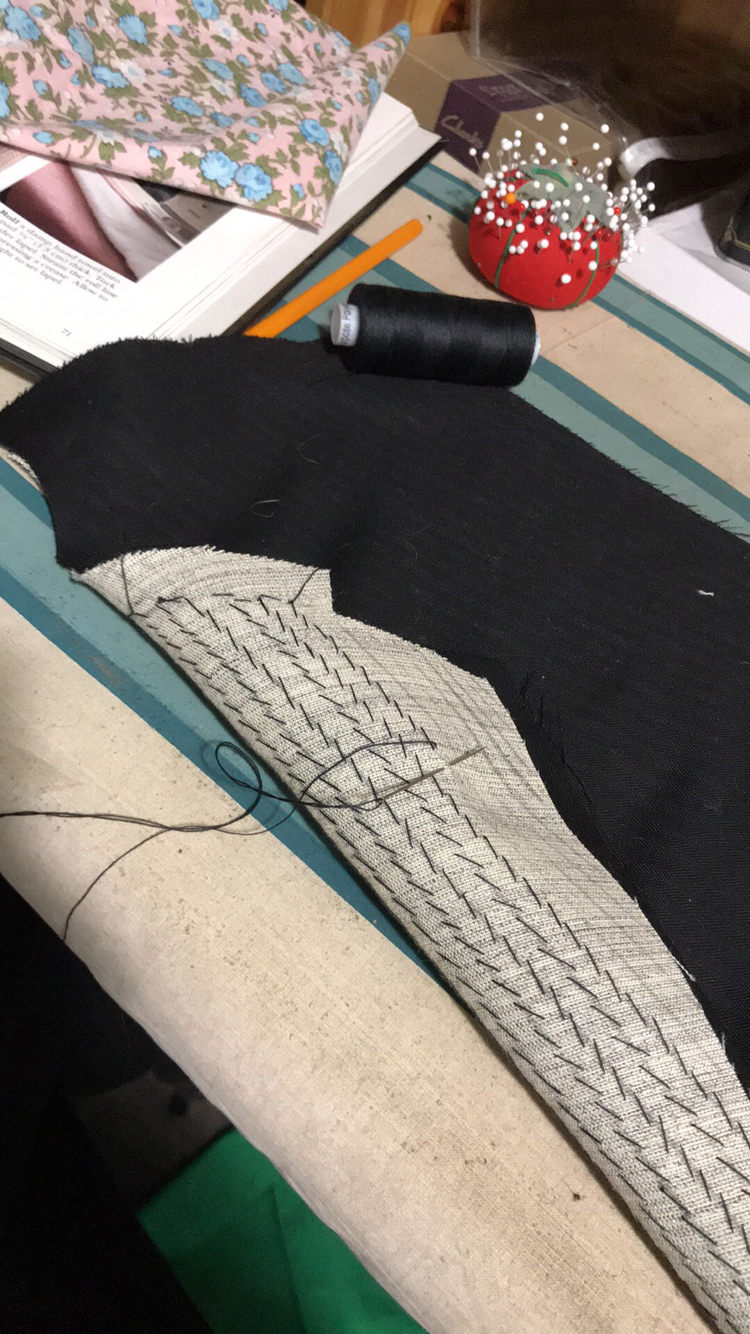 A progress shot showing hand-stitching in the lining