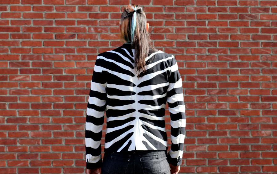 Joost wearing his Refashioners Zebra Jacket Facing back