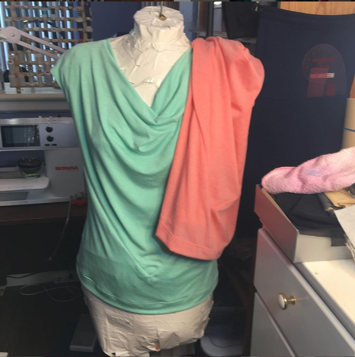 Green top with peach top draped over one shoulder