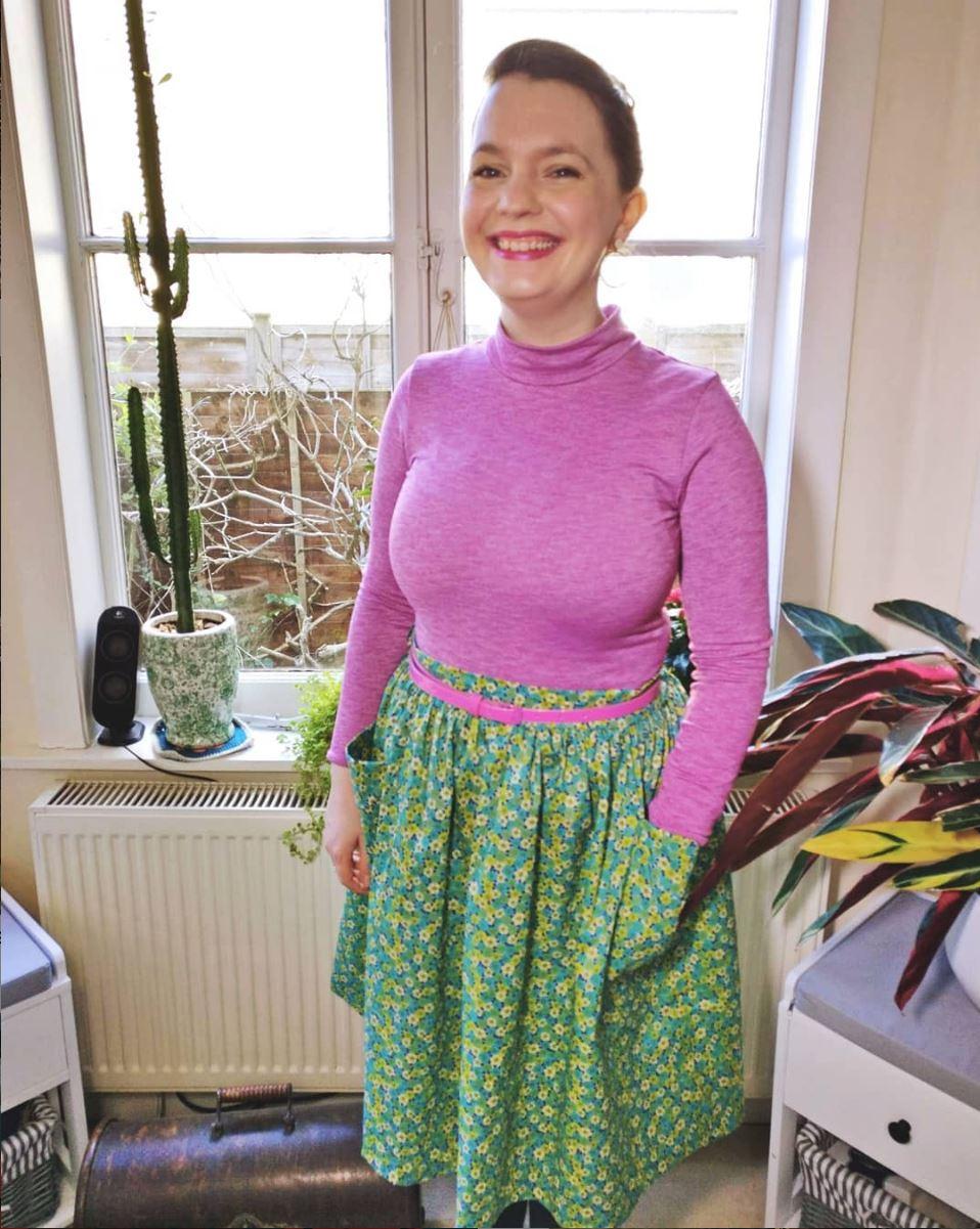 Pink top, green floral skirt