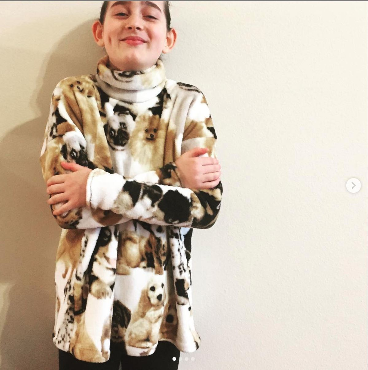 Child wearing minky fleece cowl or turtleneck jumper with printed dogs on