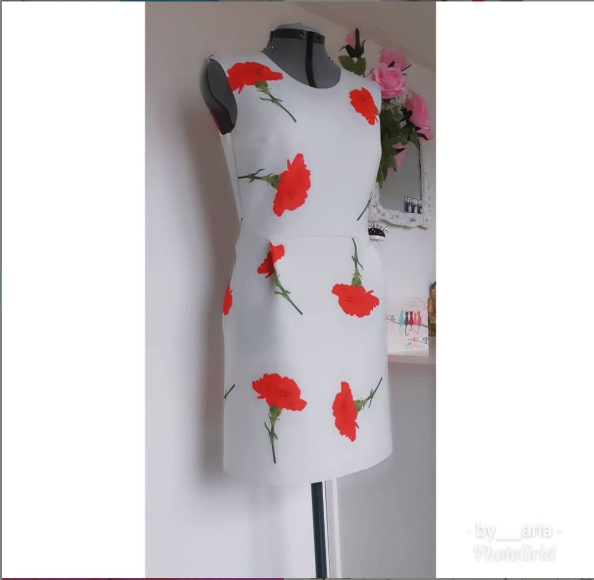 Grey dress with large red flowers on it