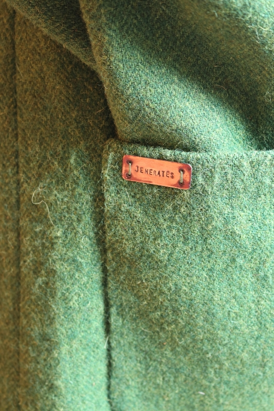 "A copper label attached to the coat sleeve ""jenerates"""