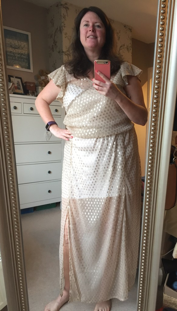 Image shows Louise in full length mirror wearing her full length dress taking a selfie