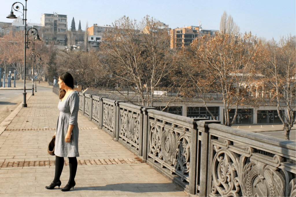 Masha models a Washi dress on a bridge over Tbilisi's Mtkvari River
