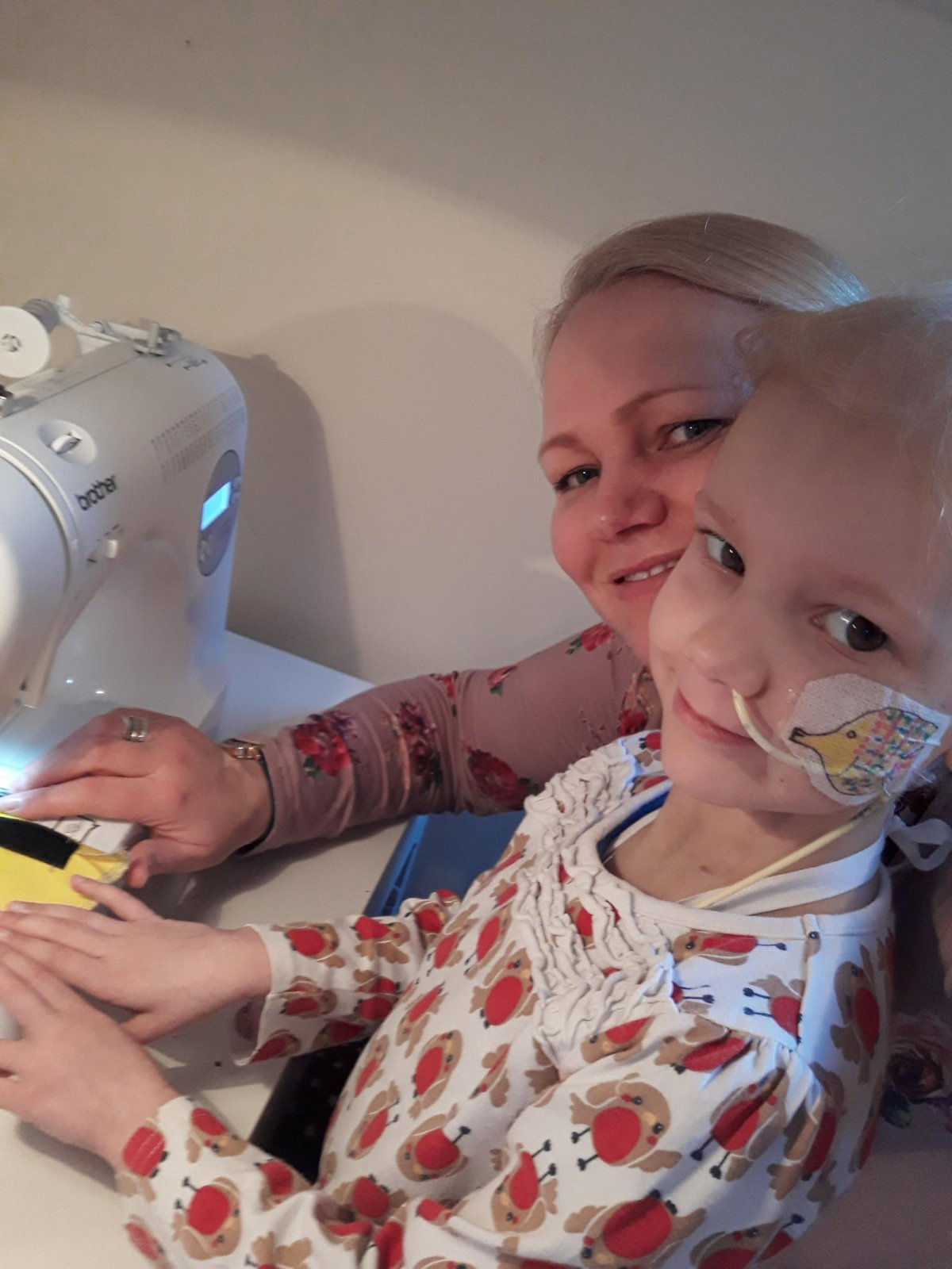 Author with daughter at sewing machine
