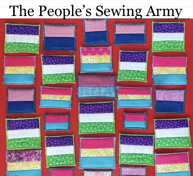 An array of brightly colored squares made of many scrap fabrics, which were donated to the Sexual & Gender Minority Resource Center.