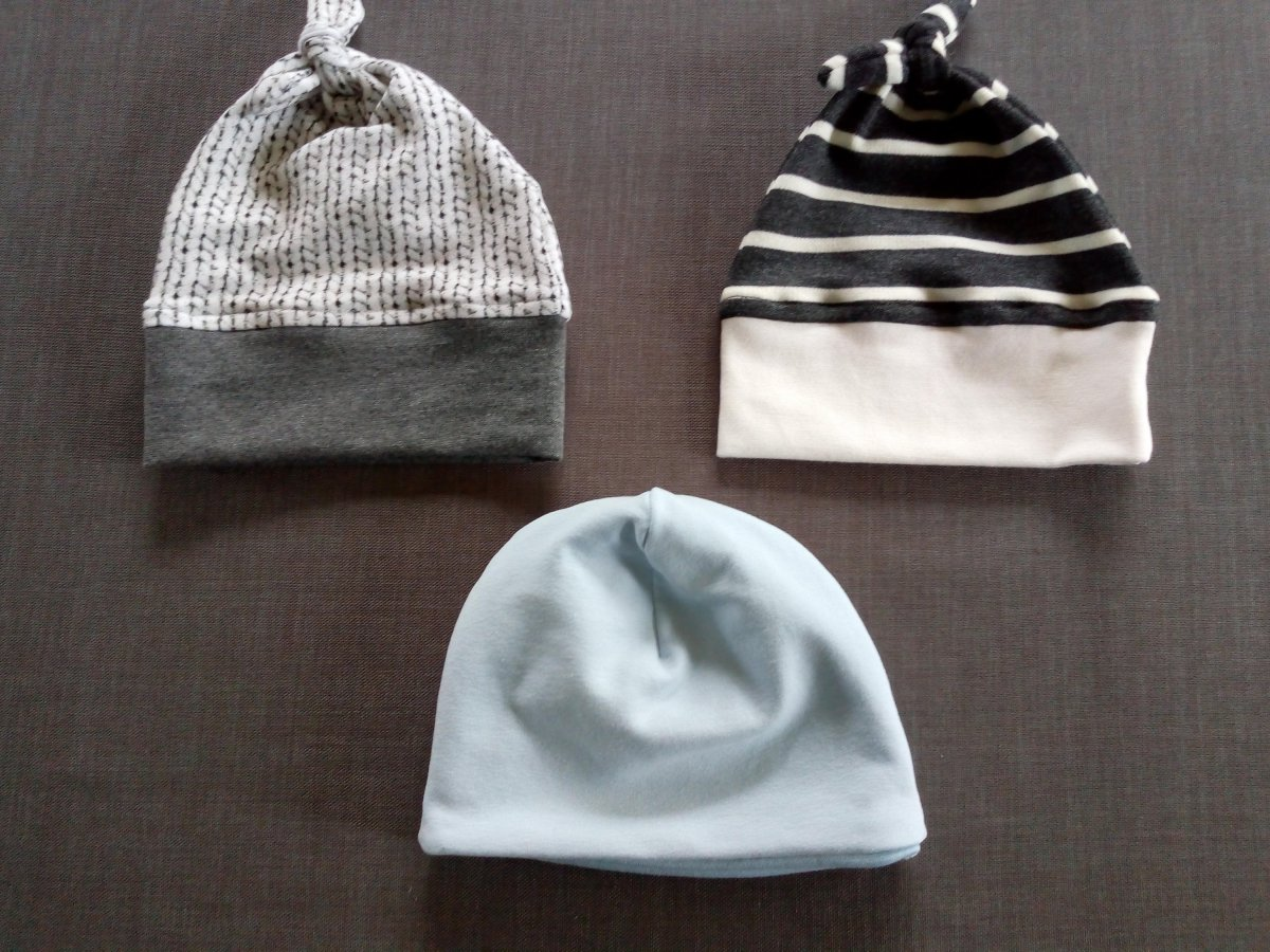 Three baby hats