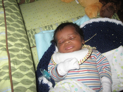 picture of black newborn baby boy sleeping.